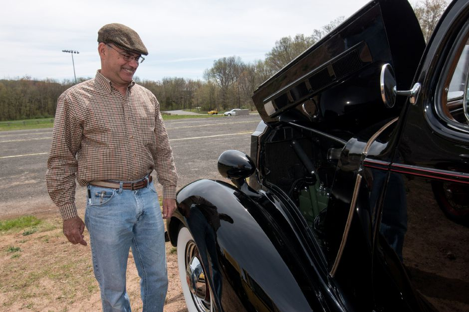 Dave Woods, of West Hartford, shows off his 1937 Packard at the Robert J. Beeney Car Show, held in memory of the Southington High School automotives teacher who passed away in 2014. The show was held at the Southington Drive-In on March 5, 2018. | Devin Leith-Yessian/Record-Journal