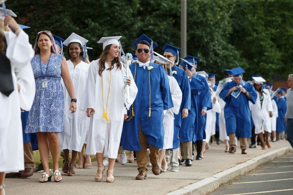 Graduates walk to the football field Thursday during Southington High School Graduation ceremonies at Southington High School in Southington June 21, 2018 | Justin Weekes / Special to the Record-Journal