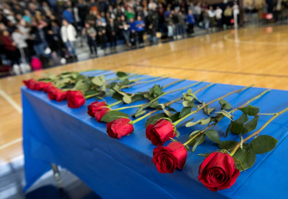 Roses placed on a table by students and staff in memory of the 17 killed in Parkland Florida as Platt High School students participate in a national school walkout, Wednesday, March 14, 2018. Dave Zajac, Record-Journal