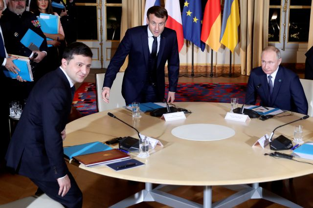 French President Emmanuel Macron, center, Russian President Vladimir Putin, right, and Ukrainian President Volodymyr Zelenskiy, left, sit before a working session with German Chancellor Angela Merkel at the Elysee Palace Monday, Dec. 9, 2019 in Paris. Russian President Vladimir Putin and Ukraine