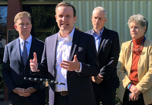 In this Oct. 18, 2018 photo, U.S. Sen. Chris Murphy, front, speaks during a campaign appearance at a senior center in West Hartford, Conn.. Joining him are Democratic gubernatorial candidate Ned Lamont, left, state Rep. Derek Slap, second from right, and state Sen. Beth Bye, right. Murphy is playing an outsized role in Connecticut