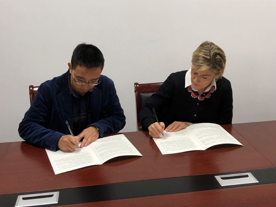 Regional School District 13 Superintendent of Schools Kathryn Veronesi signs a memorandum of understanding for a new partnership with an administrator from Tongji High School while visiting Ningbo, China in December. The partnership is expected to begin this fall with Tongji High School students visiting Coginchaug Regional High School.