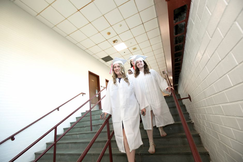 Graduates Caileigh Donnelly, left and Alexa Cherneskie head to the gymnasium as friend Isabel Cuddy follows before the start of graduation ceremonies at Cheshire High School, Wednesday, June 14, 2017. | Dave Zajac, Record-Journal