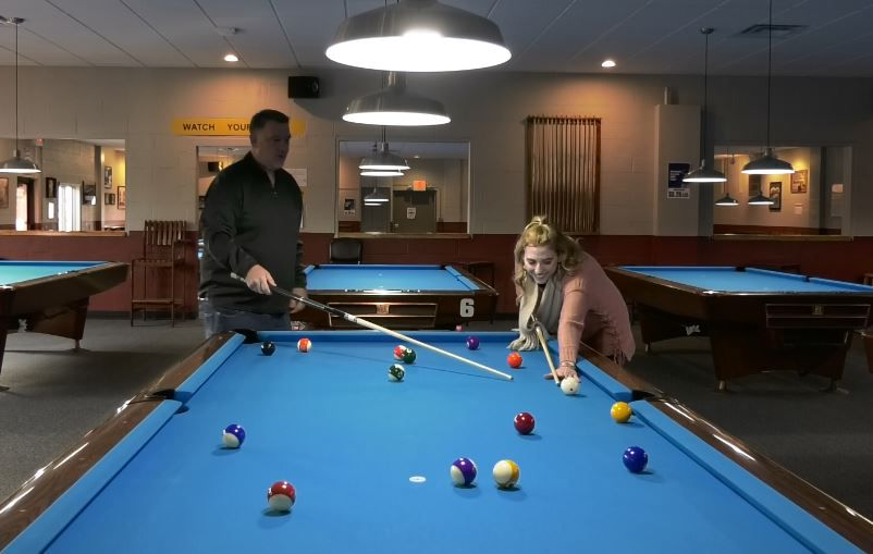Record-Journal Digital Content Producer Ashley Kus learns how to play pool from Bobby Hilton, owner of Yale Billiards at its new location at 169 N Plains Industrial Rd, Wallingford. |Ashley Kus, Record-Journal