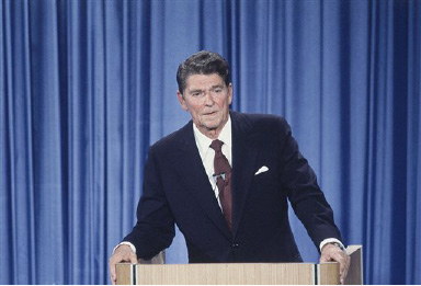 Ronald Reagan debating John Anderson in Baltimore, Md., before the League of Women Voters, Sept. 21, 1980. (AP Photo/Barry Thumma)