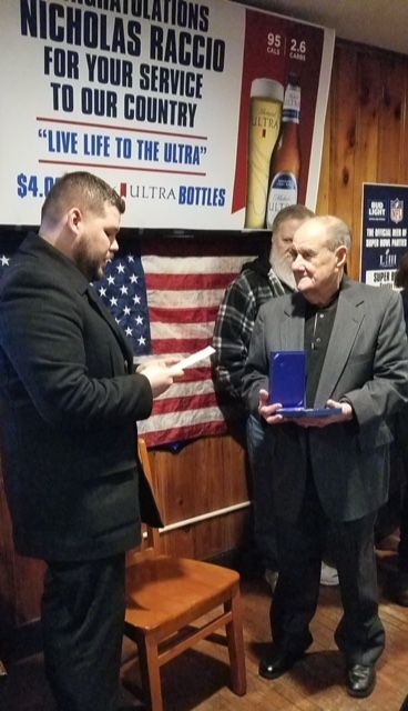 William MacMullen (left) presents North Haven resident and Korean War veteran Nicholas Raccio with a Purple Heart at Hard Hat Cafe on Tuesday, Jan. 29, 2019. | Photo Courtesy Fred Taylor