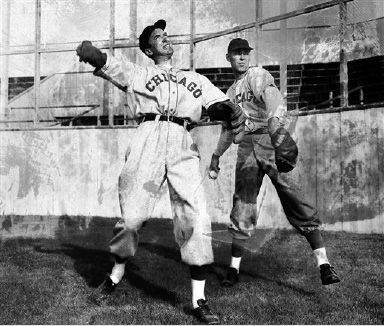 "Lanky Jimmy Stewart, left, who is scheduled to play the title role in ""The Monty Stratton Story"", warms-up under the guidance of the former Chicago White Sox Pitcher, right, in Hollywood, California on Oct. 21, 1948. Stratton lost a leg in a hunting accident about ten years ago, at the time when he was a top Sox Moundsman. (AP Photo)"