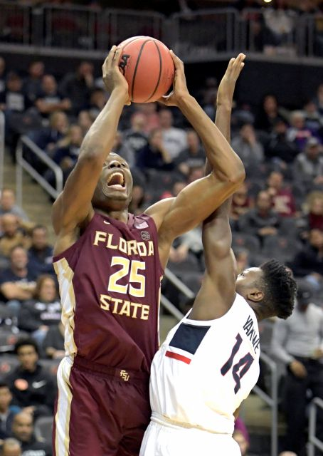 Florida State forward Mfiondu Kabengele (25) attempts a shot over Connecticut forward Kassoum Yakwe (14) during the first half of an NCAA college basketball game in the Never Forget Tribute Classic Saturday, Dec. 8, 2018, in Newark, N.J.(AP Photo/Bill Kostroun)