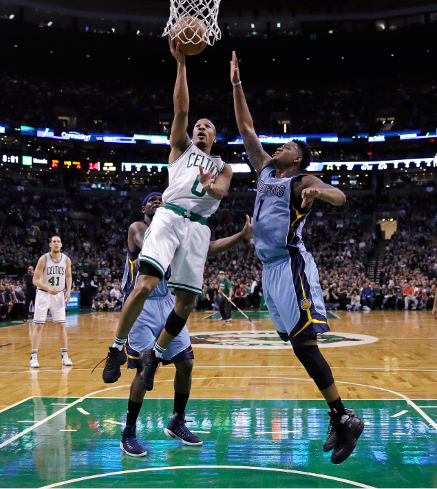Boston Celtics guard Avery Bradley (0) drives to the basket against Memphis Grizzlies forward Jarell Martin (1) during the first quarter of an NBA basketball game in Boston, Tuesday, Dec. 27, 2016. (AP Photo/Charles Krupa)