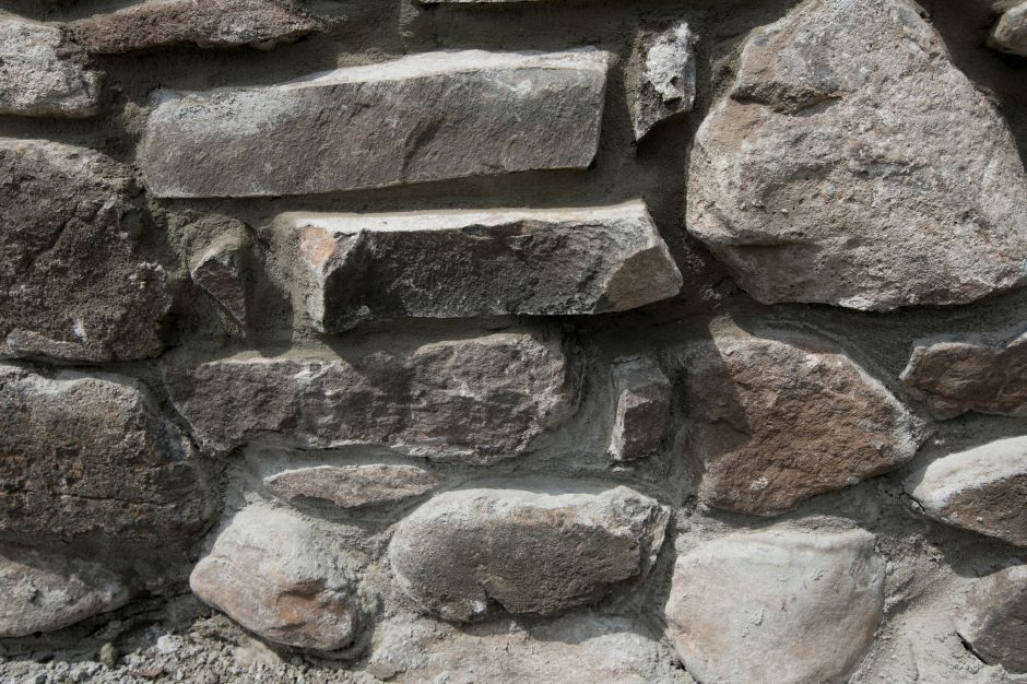 A variety of brownstone, bluestone and trap rock make up the new wall at the entrance to Giuffrida Park in Meriden, Friday, June 8, 2018. The former wall was damaged by a vehicle last year. Dave Zajac, Record-Journal