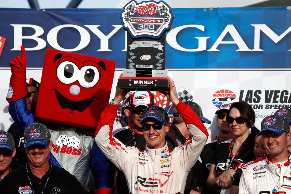 Joey Logano holds up his trophy in victory lane after winning the Boyd Gaming 300, a NASCAR Xfinity Series auto race, at the Las Vegas Motor Speedway, Saturday, March 11, 2017, in Las Vegas. (AP Photo/Steve Marcus)