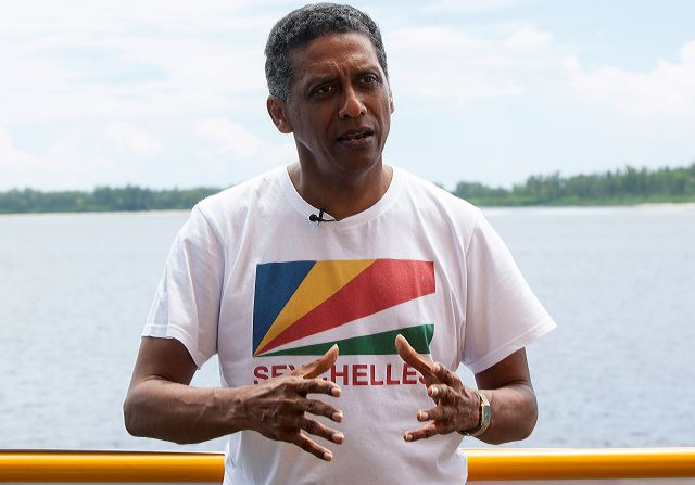 Seychelles President Danny Faure speaks during an interview with the Associated Press, on the island of Desroches, Seychelles on Sunday April 14, 2019. In a striking speech delivered from deep below the ocean