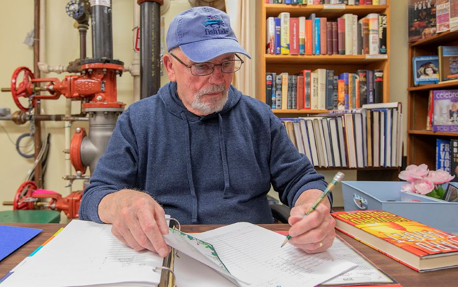 Volunteer Bill Fissette works at his desk next to fire protection piping in the Friends Used Bookstore in the basement of the Southington Public Library, Mon., May 6, 2019. The library will hold an information session on the library