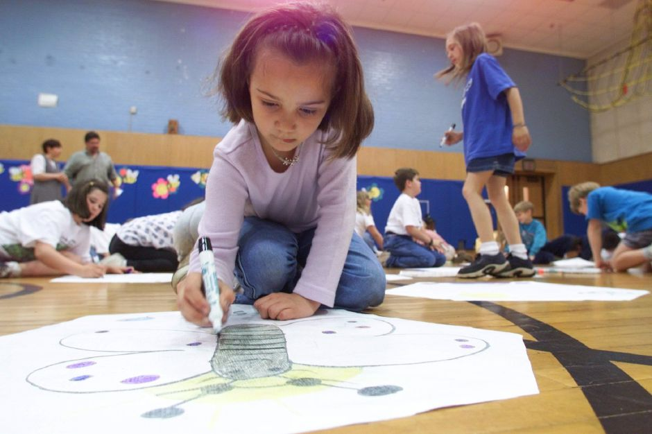 RJ file photo - Samantha Hills, 9, draws a butterfly on a kite she created at Israel Putnam School in Meriden May 10, 1999.
