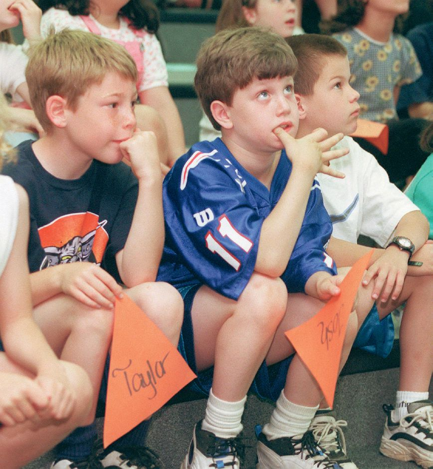 RJ file photo - From left, Highland School second-graders Joshua Barez and Zachary Vallas watch a play about geometry at Wallingford