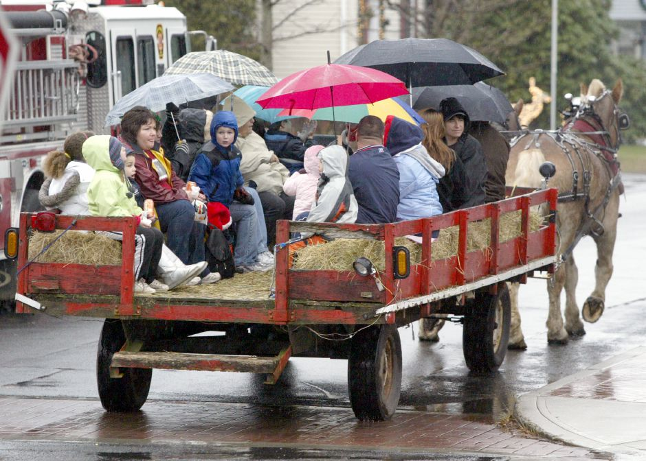 MERIDEN, Connecticut - Saturday, December 5, 2009 - People don umbrellas as they enjoy a hay ride on Saturday during South Meriden