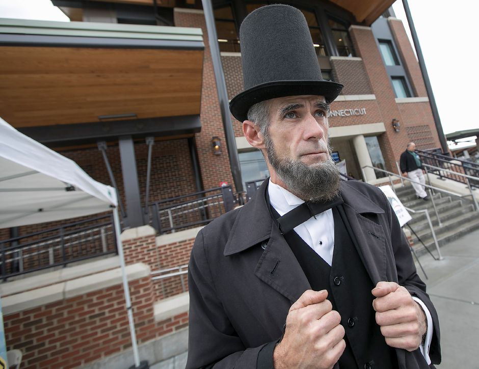 Abraham Lincoln impersonater, James Burns, of Meriden, stands in front of the Wallingford train station during its official opening, Monday, Nov. 6, 2017. | Dave Zajac, Record-Journal