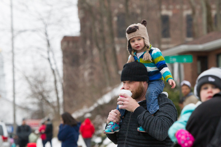 Charlotte Backus 2 gets a better view for the parade on dad Kirby Backus shoulders Saturday during the St. Patrick