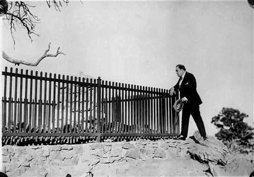 Italian opera singer, Enrico Caruso, visits the grave of Buffalo Bill, situated on Lookout Mountain, in Denver, Colo., Oct. 25, 1920. Caruso was in Denver as part of his concert tour. (AP Photo)