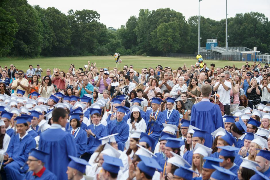 The crowd applauds students entering into the Armed Forces Friday during Lyman Hall High School