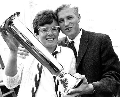 Billie Jean King, of Long Beach, Ca., U.S.A., holds her trophy as she is congratulated by her husband, Larry King, after winning the U.S. National tennis championships at Forest Hills, Queens, N.Y., Sept. 10, 1967. King defeated Ann Haydon Jones of Britain, 11-9, 6-4. (AP Photo)