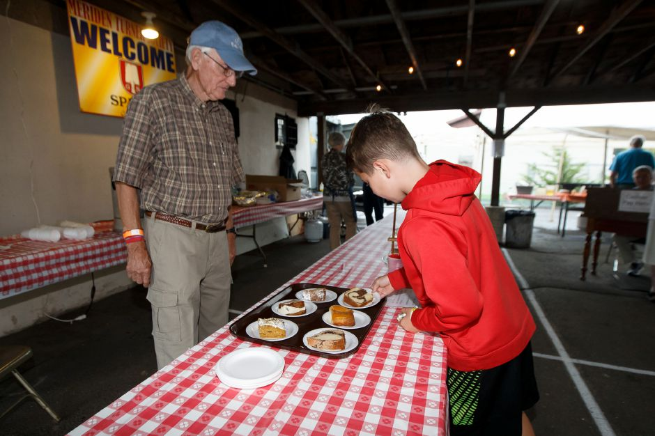 Klaus Gumz and Lachlan Griffin 11 pick out some desert Saturday during Bierfest at the Meriden Turner Society in Meriden. The 152 year old Society celebrates German cultural, food, music and dancing.  August 11, 2018 | Justin Weekes / Special to the Record-Journal