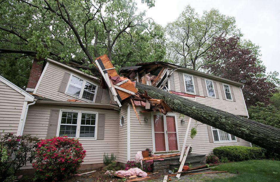 A house at 120 Bellamy Rd. in Cheshire sustained heavy damage from a large tree that fell during Tuesday