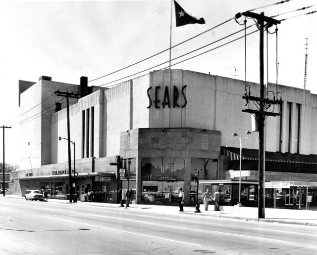FILE - This March 1, 1959, file photo shows a Sears building in downtown Houston. Sears has filed for Chapter 11 bankruptcy protection Monday, Oct. 15, 2018, buckling under its massive debt load and staggering losses. The company once dominated the American landscape, but whether a smaller Sears can be viable remains in question. (Houston Chronicle via AP, File)