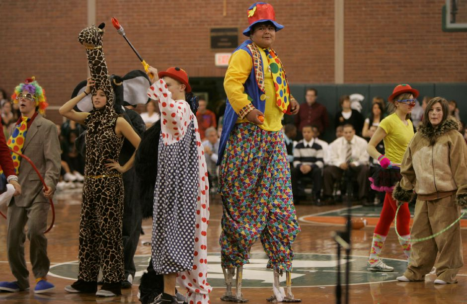 A cast of circus characters including student Erick (cq) Guzman, 18, on stilts, center, helped get the rally going during pep rally 2009 at Maloney High School November 25, 2009. (dave zajac photo)