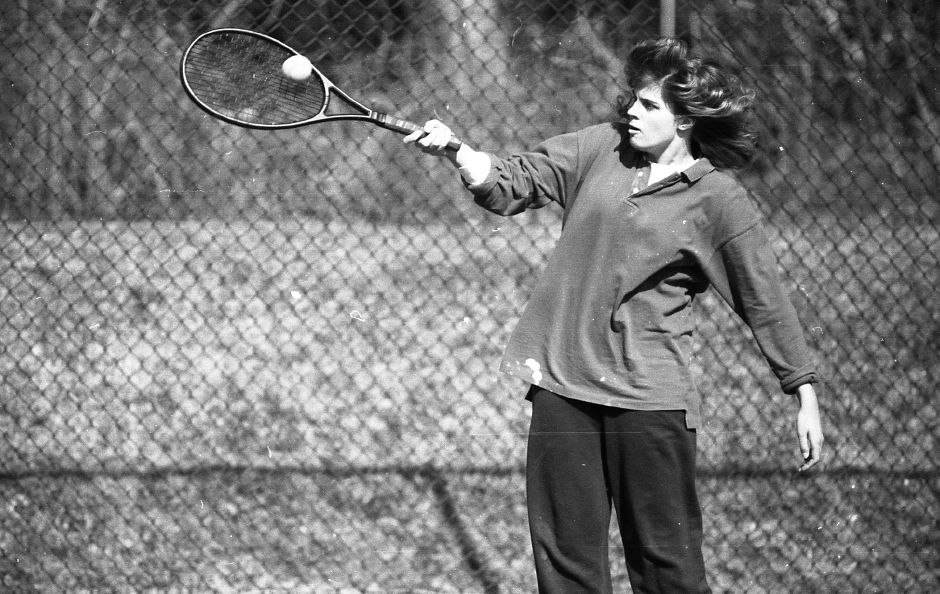 RJ file photo - Dorrey Worth hits the ball while playing with Ray Konareski at the Doolittle Park tennis courts, March 1989.