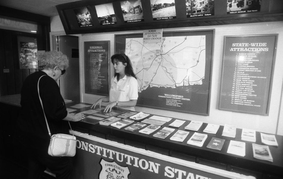 Carol Hallam of Baldwin, NY asks questions of Department of Transportation employee Kathleen Kalandyk at the information center on I-91 southbound in Wallingford, July 1989.