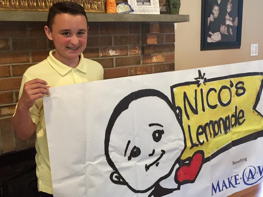 Nico Fasold will stands next to the banner for his eighth lemonade stand held Saturday, July 15, 2017 at 109 Northwest Dr. in Plainville. | Ashley Kus, The Plainville Citizen