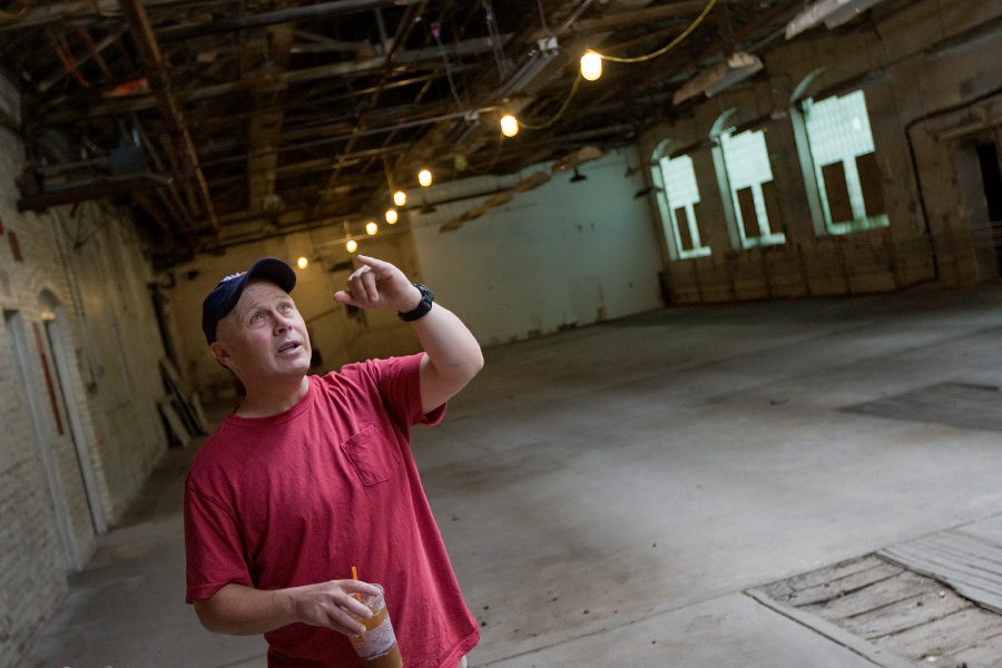Kevin Daly, of Cheshire, co-founder of Ball & Socket Arts in Cheshire, talks about ongoing renovations at the former Ball & Socket manufacturing building on West Main Street in Cheshire, Friday, July 1, 2016. | Dave Zajac, Record-Journal