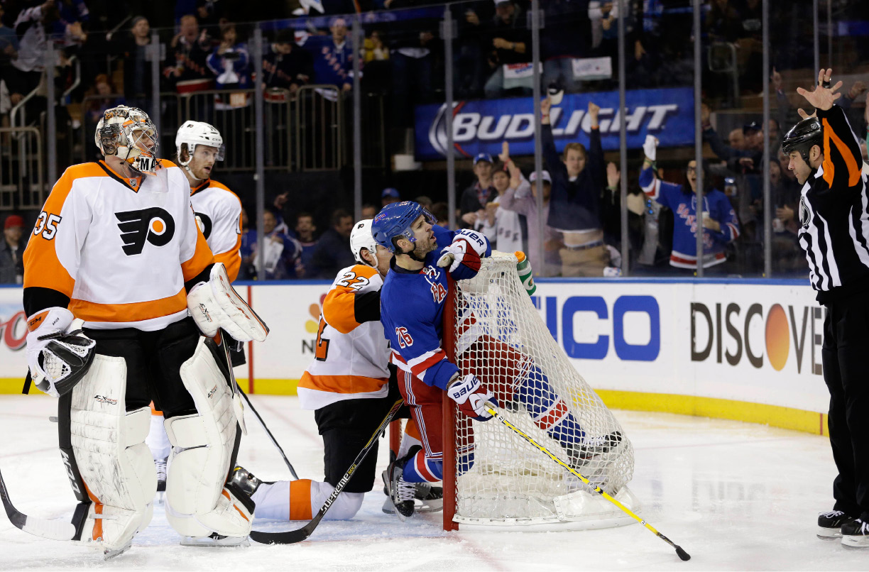 Philadelphia Flyers goalie Steve Mason, left, and New York Rangers