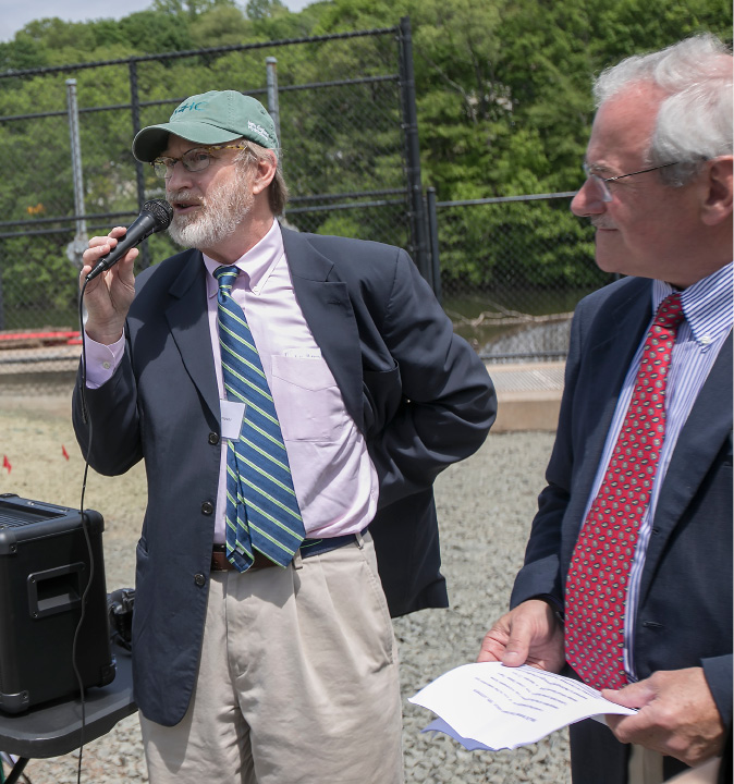 New England Hydropower Co. spokesman Chris Conover, left, speaks next to company CEO Michael Kerr during a  ribbon-cutting ceremony for the Archimedes Screw turbine installed at Hanover Pond Dam in Meriden, Wednesday, May 24, 2017. Meriden is the first city in the nation to install the technology of ancient Greek scientist Archimedes.    | Dave Zajac, Record-Journal