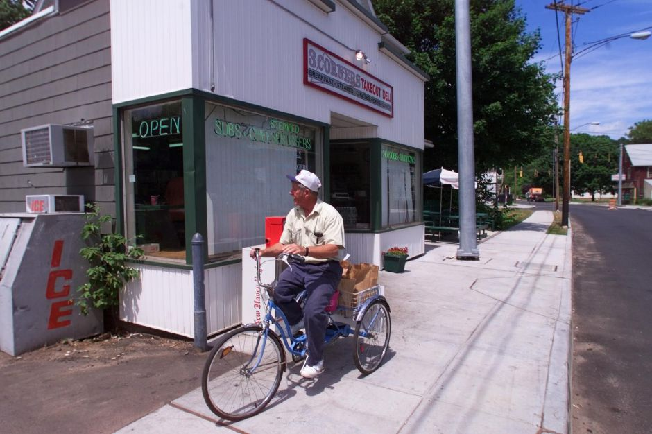 Jerry Riotte, of Wallingford, pedals away from the 3 Corners Deli in Wallingford with a lunch delivery for a local factory June 15, 1999.