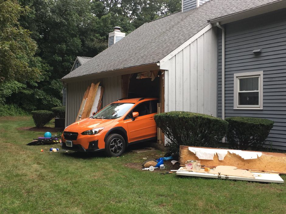 Emergency crews have responded to Old Towne Road in Cheshire after a car reportedly crashed through the back of a garage. | Ryan Chichester, Record-Journal