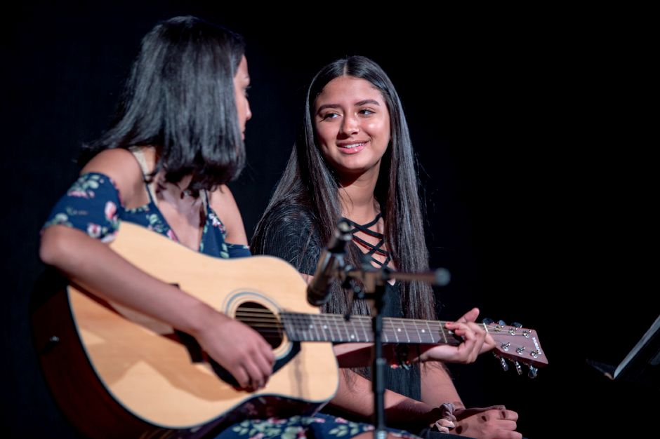 Eliana Tolentino, 17, left, and her sister, Elaine Tolentino, 14, rehearse at Sheehan High School on Wednesday. The Junior Performance Academy is holding a benefit concert for Master