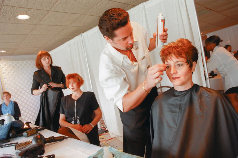 RJ file photo - Travis Knottes of Wolcott, stylist manager at Salon Josef in Meriden, puts some finishing touches on Meriden residen Lisa Scalise