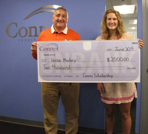 Tessa Mackey of Guilford, winner of the Arthur B. Haesche Memorial Scholarship, is presented a check for $2,000 from Connex president and chief executive officer Frank Mancini.