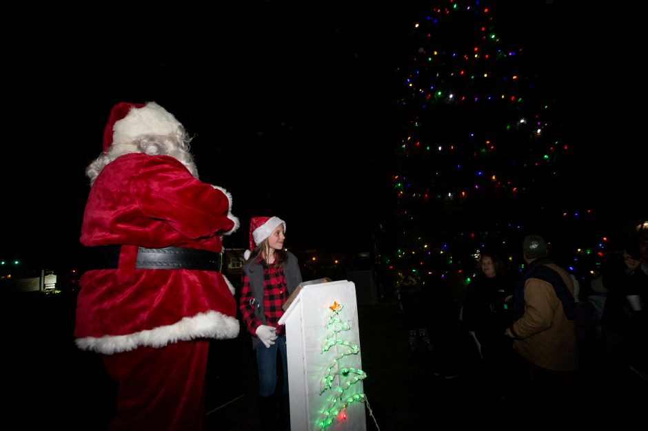 Santa with help from Adeline Galvin 10 light the tree Sunday during the annual tree lighting at the First Congregational Church in Cheshire December 2, 2018 | Justin Weekes / Special to the Record-Journal