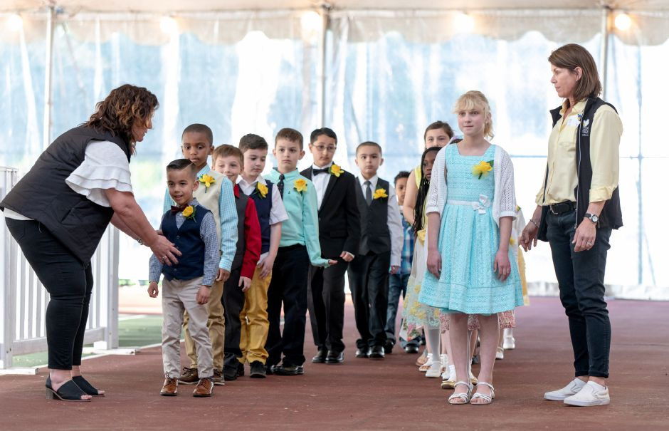 Kathryn Fuerstenberg, 10, right, and Ryder Brechlin, 6, are presented to the crowd for MIss Daffodil on April 24, 2019. The two students, from Mount Carmel school, were some of the 18 elementary students in the running to be selected by raffle to head the Daffodil Festival Parade April 27. | Devin Leith-Yessian/Record-Journal