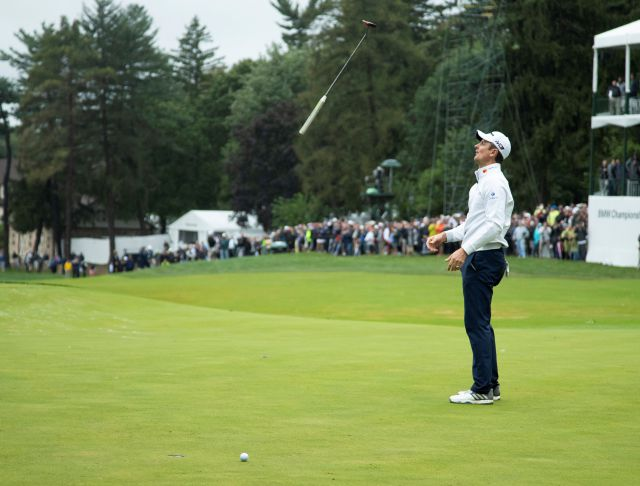 Justin Rose, of England, tosses his club after missing a putt for par on the 18th hole during the BMW Championship golf tournament at the Aronimink Golf Club, Monday, Sept. 10, 2018, in Newtown Square, Pa. Keegan Bradley held off Justin Rose in a sudden-death playoff to win the rain-plagued BMW Championship for his first PGA Tour victory in six years. (AP Photo/Chris Szagola)