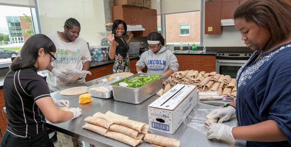Waterbury teacher Jahana Hayes, center, has some fun with Change the Play members while helping prepare meals for the city's Free Summer Meals program at Maloney High School, Wednesday, August 1, 2018. Hayes, a former National Teacher of the Year, is running against Mary Glassman in the Democratic fifth district primary. Dave Zajac, Record-Journal