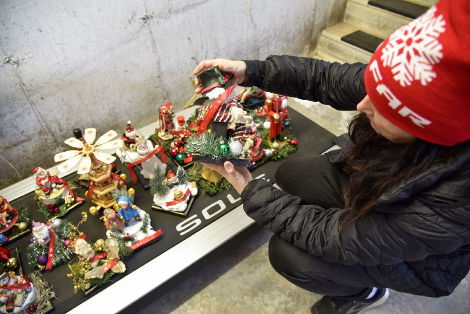 Jennifer Schulten, founder of Go Far, looks at trophies in various stages in the workshop where she and a fellow race coordinator put together unique homemade trophies for the fastest and most festive runners at their annual Go Far Jingle All the Way 5K. | Bailey Wright, Town Times