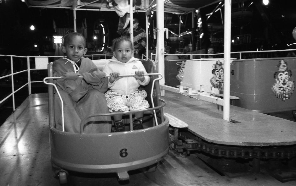 RJ file photo - Milton and Gina Luzunaris enjoy carnival rides at the Meriden Expo Oct. 15, 1993.