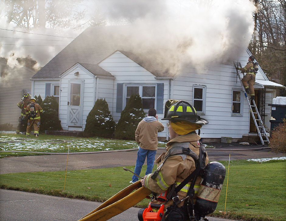 Firefighters battle an attic fire at 99 Jepson Lane in South Meriden Wednesday afternoon Nov. 28, 2012. (Richie Rathsack/Record-Journal)