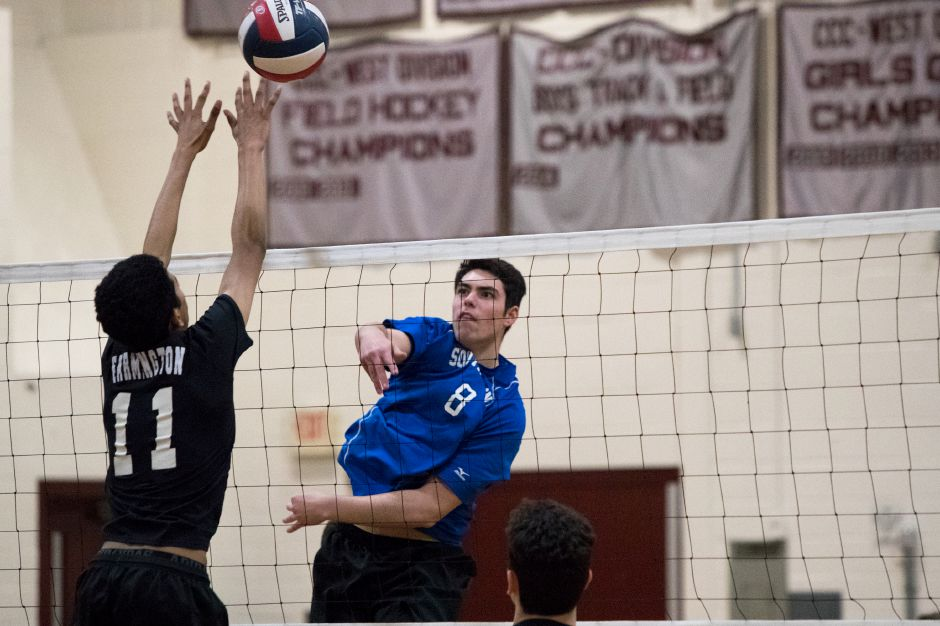 Southington's Rocco Possidento gets a spike over Farmington's Sachit Sabapathy, left,  at Farmington High School on Monday. Southington won 3-0 by game scores of 25-14, 25-21 and 25-21.Photos by Justin Weekes, special to the Record-Journal