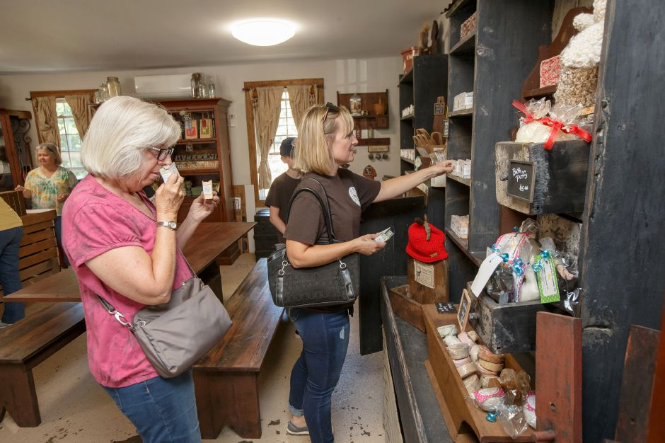Cathy Kaliss of Meriden left and Rebecca Chancey of Plainville shop for soap in the store Sunday during an open farm day at Bradley Mountain Farm in Southington July 8, 2018 | Justin Weekes / Special to the Record-Journal