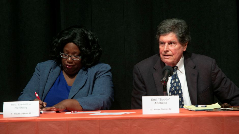"Rep. Emil ""Buddy"" Altobello, D-Meriden speaks next to Republican challenger the Rev. Ernestine Holloway during a debate at Washington Middle School sponsored by the Record-Journal, Midstate Chamber of Commerce, and Meriden Board of Education, Thursday, Oct. 18, 2018. Republican, Democratic and Libertarian candidates in three local races were sharply divided Thursday on the implementation of tolls, how to close a 4.5 billion deficit, and other issues. Dave Zajac, Record-Journal"